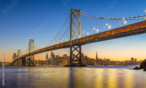 Spoed Foto op Canvas San Francisco San Francisco skyline with Oakland Bay Bridge in twilight, California, USA