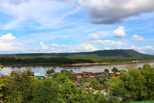 Mekhong River Looking From Thailand Village To Laos' Mountain With Cloudy Blue Sky