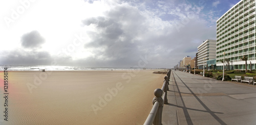 Virginia Beach boardwalk and beach under windy skies