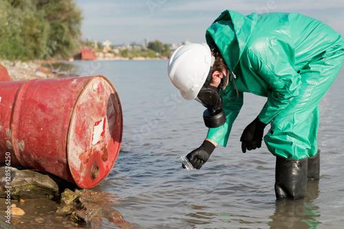 Obraz na plátně  Pollution inspector.Pollution inspector taking sample of water