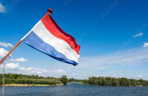 Fotografía  Dutch national flag on the stern of a boat