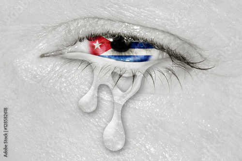 Fotografie, Obraz  Crying eye with Cuba Flag iris on black and white face