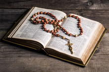 Rosary On Old Bible