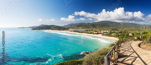Photo  Coast with long beach, view from the promontory in a sunny day - Sardinia, Santa