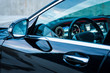Luxury car interior details. Dashboard, steering wheel