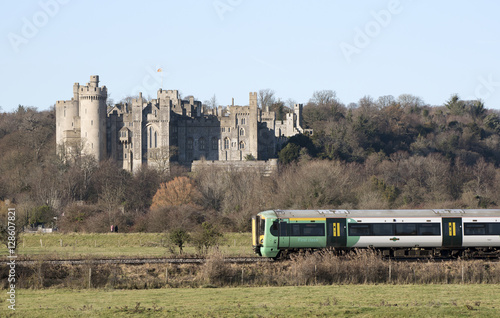 Stampa su Tela  Passenger train passing a historic castle England UK November 2016 - A southern