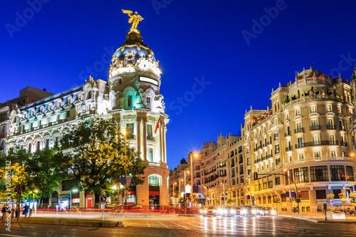 Poster Madrid Madrid, Spain. Gran Via, main shopping street at dusk