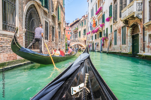 Poster Venise Gondola ride through the canals of Venice, Italy