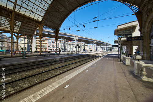 Canvas Prints Train Station France, Nice, 15 august 2016: Panorama of the railway station in the center, sunny day, blue sky, a lot of tourists, Rails under glass a roof, in front of shaped visor, sncf, gare