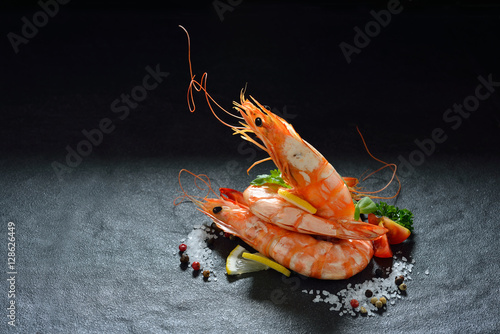 Cooked shrimps,prawns with seasonings on stone background Canvas Print