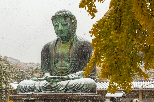 Tuinposter Japan The Great Buddha in Kamakura.It's snowing. Located in Kamakura, Kanagawa Prefecture Japan.