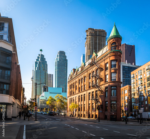 Deurstickers Toronto Gooderham or Flatiron Building in downtown Toronto with CN Tower on background - Toronto, Ontario, Canada