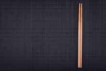 Chopsticks On Black Bamboo Mat