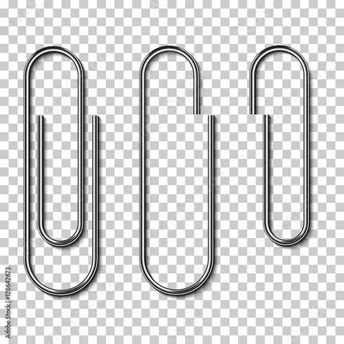 Photo  Metal paperclips isolated and attached to paper