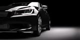New black metallic sedan car in spotlight. Modern desing, brandless.