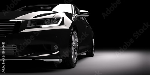 Photo New black metallic sedan car in spotlight