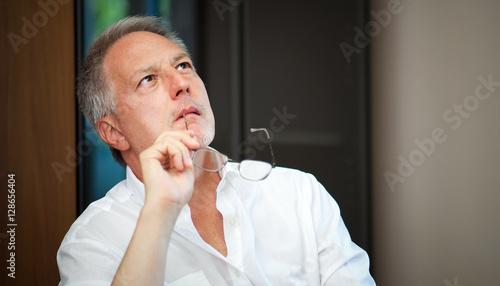 Valokuva  Portrait of a pensive businessman