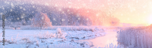 Christmas sunny background. Panoramic landscape of frosty winter Canvas Print