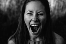 Young Pretty Dark Hair Woman Screaming