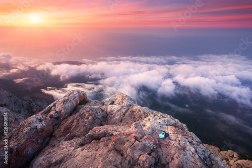 Cadres-photo bureau Lavende Mountain landscape at sunset. Amazing view from the mountain peak on rocks, low clouds, blue sky in the evening. Colorful nature background. Adventure. Travel in Crimea. Beautiful scenery at twilight