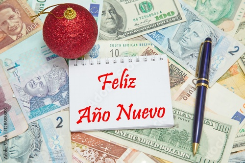 notebook page with spanish text feliz ao nuevo happy new year