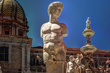 Fototapeta na wymiar Beautiful sculpture of the famous fountain of shame on baroque Piazza Pretoria, Palermo, Sicily, Italy