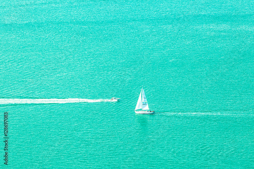Wall Murals Green coral Speed boat and sailboat.