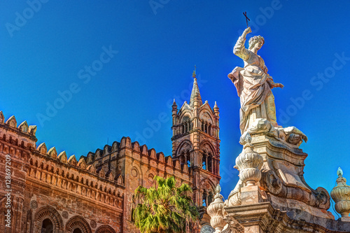 Palerme Sculpture in front of Palermo Cathedral church against blue sky, Sicily, Italy