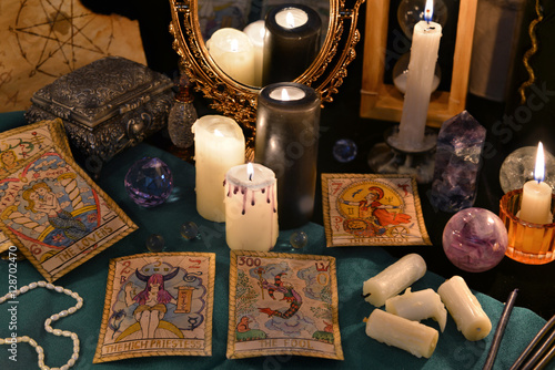 Staande foto Vlees Magic still life with crystals, the Tarot cards and candles by the mirrow