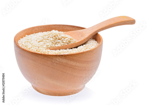 white sesame in wooden bowl on white background