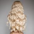 Leinwandbild Motiv Portrait Of A Beautiful Young Blond Woman With Long Wavy Hair.