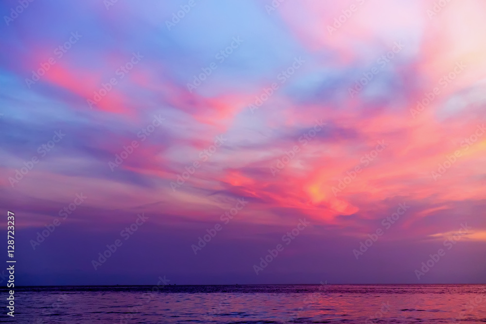 Fototapeta Tropical colorful dramatic sunset with cloudy sky and silhouette of the ship on the horizon. Evening calm on the Gulf of Thailand. Bright afterglow.