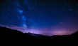 canvas print picture - night sky stars milky way blue purple sky in starry night over mountains