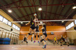 Women playing volleyball match
