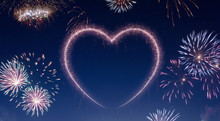 Night Sky With Fireworks Shaped As A Heart.(series)