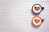 Fototapeta Kawa jest smaczna - Two cups of coffee with heart shape symbol