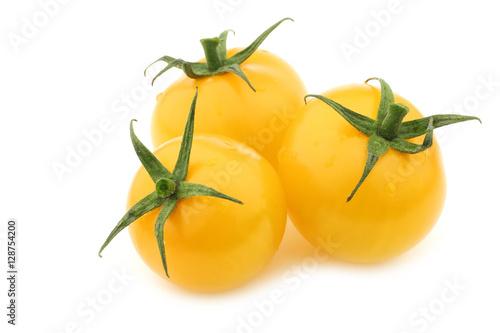 fresh dutch yellow tasty tom tomatoes on a white background Canvas Print