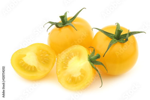 fresh dutch yellow tasty tom tomatoes and a cut one on a white background Canvas Print