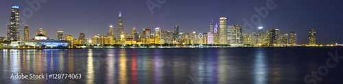 Poster Chicago Night panoramic picture of Chicago city skyline with reflection in Lake Michigan.