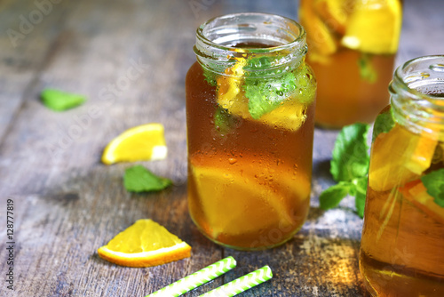 Valokuva  Orange iced tea in a glass jar.