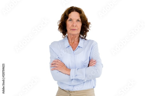Foto  Serious mature woman with arms crossed