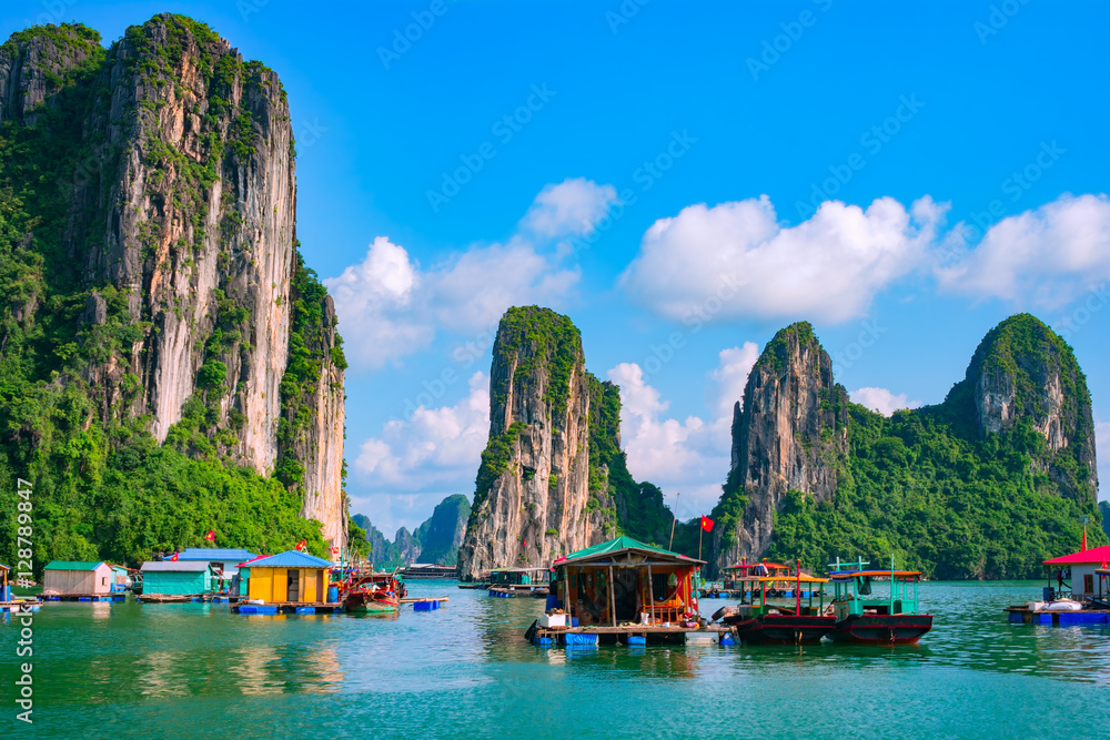 Fototapety, obrazy: Floating fishing village and rock island in Halong Bay, Vietnam, Southeast Asia. UNESCO World Heritage Site. Junk boat cruise to Ha Long Bay. Landscape. Popular landmark, famous destination of Vietnam