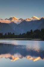 New Zealand, South Island, West Coast, Fox Glacier Village, Lake Matheson, Reflection Of Mt. Tasman And Mt. Cook, Dusk