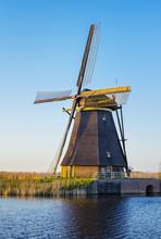 Netherlands, South Holland, Kinderdijk, UNESCO World Heritage Site. Historic Dutch Windmill On The Polders.