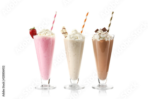 Photo Stands Milkshake Delicious milkshakes isolated on white