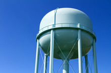 Water Tower With Blue Sky In T...