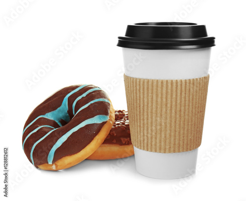 Cup of coffee with tasty donuts on white background