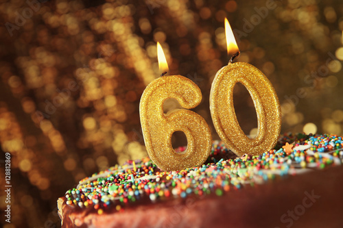 Fotografía  Birthday cake with burning candles on blurred background