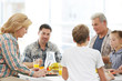 Happy large family having breakfast on kitchen