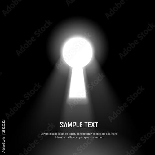 Photo Key hole on black wall with light and shiny glow effect